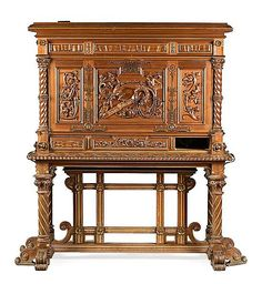 """<b>Francesc Vidal i Jevellí</b> <br  /> Barcelona 1847 - 1914 <br  /> Writing desk <br  /> Carved and partially gold-plated walnut. Interior in rosewood, mahogany and mother-of-pearl simile. Gold-plated bronze decorations on felt <br  /> Matching buffet.  Circa 1895. A carved and gold-plated inscription on the centre of the hinged lid: """"Sempre guardant tresors"""". A bottom drawer and some decorative pieces are missing.  Without key <br  /> 91,5x137x61 writing desk and 84,5x170,5x70 cm buffet…"""