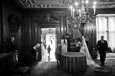 A bride gets ready for her entrance into her Pegasus Garden ceremony as a young ring-bearer catches up to the procession.