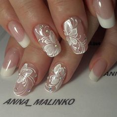 Beautiful nails, be very pretty for a bride. Love the rounded shape of the nails too, don't like squared off nails, too much like a snow shovel.