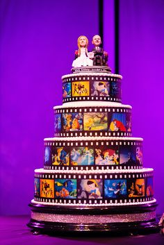Disney film strip wedding cake with custom bobblehead bride + groom topper