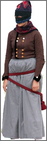 The Fanoe dress, Denmark. Traditional working dress. The special head cover was to protect against the wind on the Danish windy fields. | Fanødragten - Arbejdsdragt