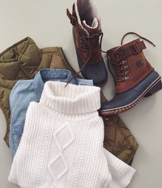 Chunky knit sweater, chambray, & puffer vest.