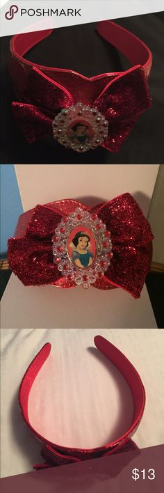 Disney Snow White headband Your little princess will be the fairest one of all when she wears this bright-red Snow White headband! There's plenty of sparkle on the bow to allow her to shine.  * Snow White cameo with bejeweled detailing * Headband with ribbon and glitter accents * Plastic/polyester/PVC * One Size Fits All Disney Accessories Hair Accessories