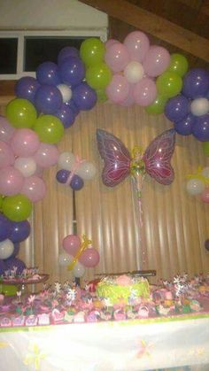 Pink, green, purple, white balloons