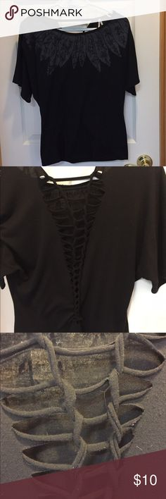 Fun black top !! This is a fun black top. There is bling on the front and a ladder design on the back. It's a size medium and fits true to size. Max Tops