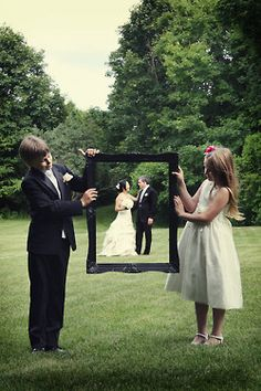 cute photo op - when we have a fam we could have our kids hold the frame