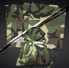 Get camo fabric from Walmart.. Too cute!!!!   Use Bandanas for favor bag