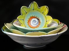 I absolutely love everything she makes!!!! Yellow Lotus bowls
