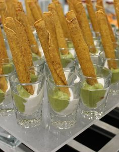 Here's a creative idea for party food - Flautas Appetizers. Flautas are placed upright in shooter glasses paired with guacamole and sour cream carefully spooned in the bottom which serve double duty as dips and make them visually pleasing. Mexican Birthday Parties, Mexican Fiesta Party, Fiesta Theme Party, Taco Party, Snacks Für Party, Appetizers For Party, Appetizer Recipes, Shot Glass Appetizers, Birthday Appetizers