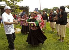 Kallawaya | Kallawaya weaver and ritualist Lola Palluca Nina de Quispe dances with a visitor to the music of Los Masis, a Quechua musical group from Bolivia. | Photo by Maggie Pelta-Pauls, Ralph Rinzler Archives and Collections, Smithsonian Institution