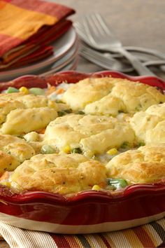 This gluten-free chicken pot pie recipe features a sage-infused chicken and vegetable filling and a gluten-free dumpling topping. A perfect comfort food dish for winter cooking.