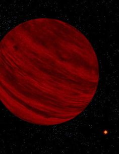 This is an artist's interpretation of the brown dwarf  Gl 229B. It has a dull red color that the eye can see with the luminosity coming out of the infrared.  There are some magnetic spots seen on this image as it is thought that younger brown dwarfs posses magnetic fields. This dwarf is to be said 40 AU away. Image by Pat Rawllings