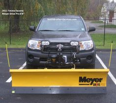 """2011 Toyota Tacoma with Meyer Drive Pro 6' 8"""" snow plow."""
