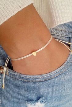 Tiny heart bracelet, wish bracelet, gold bracelet, friendship bracelet, bridesmaid gift You can wear this bracelet alone or stack it with others! This listing is for one bracelet. Details: ♥ Tiny heart charm (5mm) ♥ Nylon waxed cord (1mm) ♥ The bracelet is adjustable ♥ Four #GoldBracelets