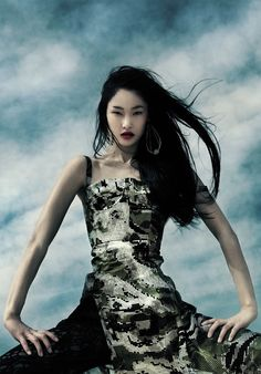 Dramatic fashion photos by Dinara Chetyrova by Jamie Nelson for Elle Vietnam 2011