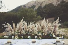 Trend Alert: 23 Gorgeous Ways To Use Pampas Grass for Your Wedding (Bridal Musings) Grass Centerpiece, Feather Centerpieces, Centerpiece Ideas, Table Centerpiece Wedding, Floral Wedding, Wedding Bouquets, Wedding Flowers, Trendy Wedding, Feather Wedding Decor
