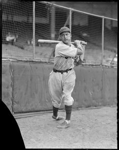 Chicago Cub Billy Herman swinging a bat in front of the screen at Braves Field, 1932.
