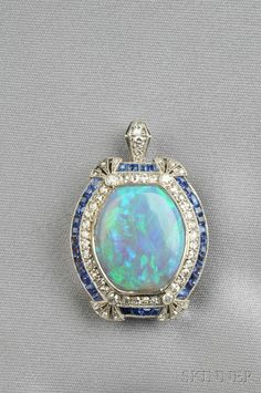 An Art Deco Platinum, Opal, Sapphire & Diamond Pendant, bezel-set with an… Art Deco Jewelry, Gemstone Jewelry, Fine Jewelry, Jewelry Necklaces, Jewelry Design, Jewlery, Silver Jewelry, Heart Jewelry, Silver Ring