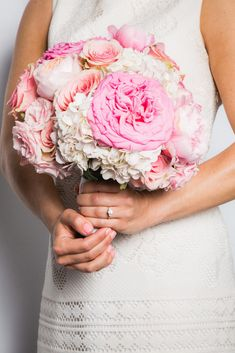 If you're all about the wedding details, then your manicure will factor into that. Your nails need to perfectly complement your rings, skin tone, and, of course, the wedding bouquet! Like this Coral Hint color.