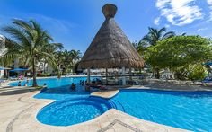 Relax Pool at The Reef Playacar- This all-inclusive beachfront resort has everything for your dream vacation. Stay here and enjoy the endless adventures Mundo Maya has to offer.