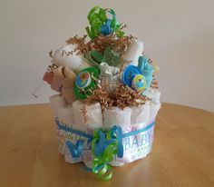 this adorable diaper cake to give at a shower or after baby is born