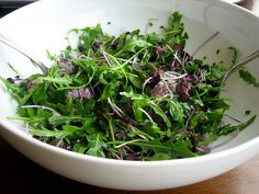 Arugula with Radish Sprouts and Chive Blossoms.. daaaa bomb