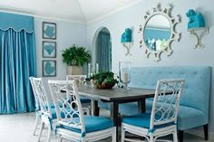 White chairs in blue color scheme