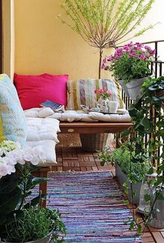 Love the idea of benches lining the wall/rail. You could store a small table, footstool, or outdoor poufs under it!