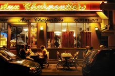 """Paris restaurant Aux Charpentiers, where a waitress used every possible word except canard to describe a daily special and finally quacked like a duck to tell me what it was. Then she said it was not good...long, long pause...""""Il est excellent."""""""