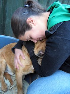 Danny DeVito the rescued dog being hugged by volunteer and friend Filipa. Danny has been waiting for 5 years to be adopted