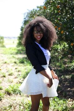 breeanalamar:  Black Girl with natural Afro hair.    Beautiful. I love the contrast of a white shirt or shirt against dark skin.