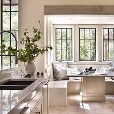 transitional white kitchen filled with light and open to views-ample room for cooking and dining in a relaxed elegant style - lots of magic in this wonderfully dreamy room