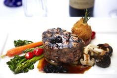 Our Filet Mignon to die for!  With green  black peppercorn sauce, broiled to perfection and served with seasonal vegetables.  visit: francescos.com