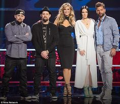 On the panel: The Madden's sit alongside Delta Goodrem, Jessie J and Ricky Martin during The Voice Joel Madden, Jessie J, Ricky Martin, All Smiles, Selena, My Idol, The Voice, Sydney, That Look