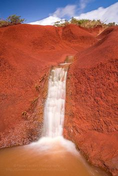 Red dirt waterfall, Kauai, Hawaii by Pierre Leclerc. Kauai Vacation, Vacation Places, Vacation Destinations, Dream Vacations, Vacation Trips, Places To Travel, Italy Vacation, Holiday Destinations, Vacation Spots