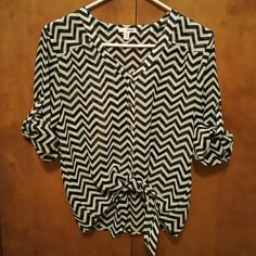 Black and white sheer top Black and white sheer high low top with tie in front. Can be worn with long sleeves or elbow length sleeves. Never worn. Perfect condition. BONGO Tops Blouses