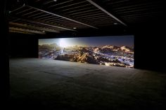 Kelly Richardson (Canadian, born 1972). Installation view of Mariner 9, 2012. Three-channel high-definition video installation with 5.1 audi...
