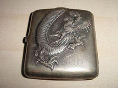 Sterling dragon cigarette case.