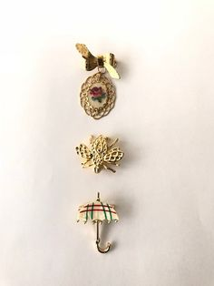Excited to share the latest addition to my #etsy shop: Vintage - Gold Tone Pins - Umbrella - Cross Stitch - Bug https://etsy.me/2qnAd8R #jewelry #no #unisexadults #umbrella #pin #bug #crossstitch #goldtone #vintage