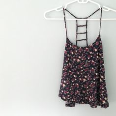 "• Forever 21 Floral Cage Back Tank • •Info Worn a few times, in excellent condition. Selling because it's gone untouched for quite some time!  •Measurements  Length: 14"" Width: 17""  •Materials 100% Viscose  •Care Hand wash cold, dry flat, do not dry clean.   ~No trades, 24 hour holds only, no PayPal~ Forever 21 Tops Tank Tops"