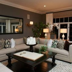 Great wall color and neutral scheme for this den. What a perfect couch, too! @David Nilsson Engle