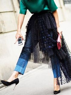 voluminous tulle skirt worn over straight leg jeans - this would make an awesome holiday look!