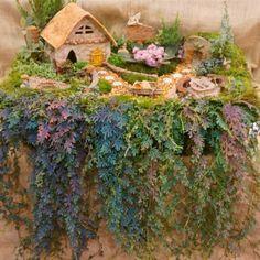 The fairy garden of all fairy gardens!    www.wholesalefairygardens.com