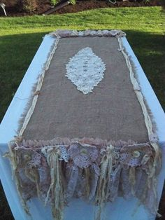 Table runner of burlap, old doilies and lace scraps