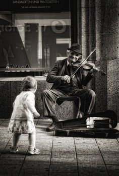 Street musician performs while a child dances. Black and white… Sponsored Sponsored ZsaZsa Bellagio. Street musician performs while a child dances. Black and white photograph. Black White Photos, Black And White Photography, Life Photography, Vintage Photography, Photography Ideas, People Photography, Landscape Photography, Photography Colleges, Photography Lighting