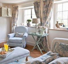Beautiful English cottage look... love the gingham with the soft toile and sisal rug