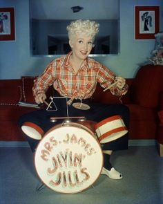 Betty Grabble playing the drums, 1940s casual jeans plaid shirt red white shoes vintage fashion