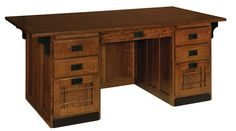 Amish Mission Executive Desk Raised panels, decorative inlays, and curving corbels look lovely on this executive mission style desk.