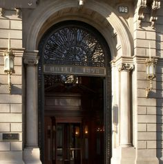 Hotel 1898 Barcelona. Hop into the lift and go up to the rooftop on the 7th floor you will come directly out on to the bar order a drink and enjoy a breath taking view of the city in the day or night. Don't forget to thank us.