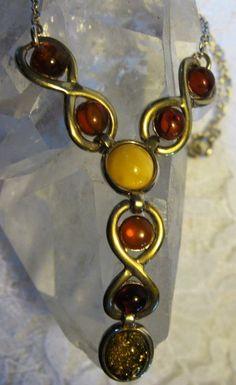 Online veilinghuis Catawiki: Sierlijk zilveren collier met Baltisch Amber